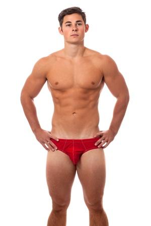 wit ondergoed: Jonge volwassen man in ondergoed. Studio shot over wit. Stockfoto