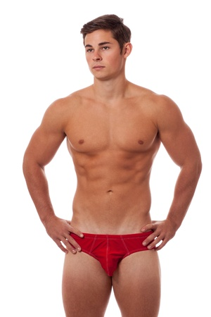 man underwear: Young adult man in underwear. Studio shot over white. Stock Photo