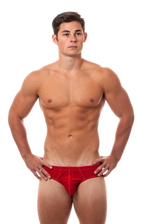 briefs: Young adult man in underwear. Studio shot over white. Stock Photo
