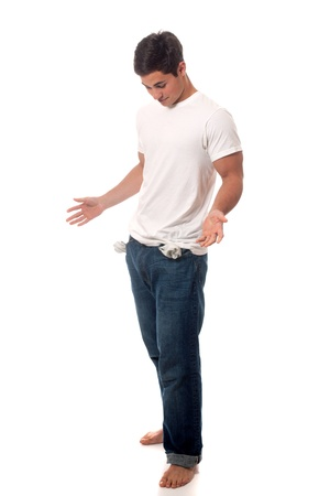 empty pockets: Casual young man. Studio shot over white. Stock Photo