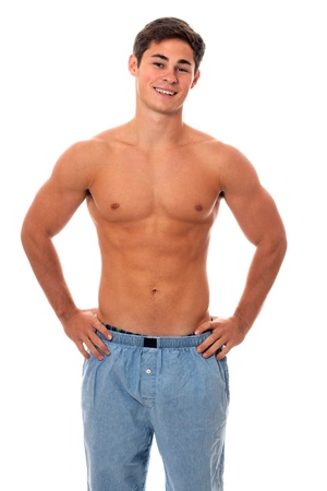 shirtless male: Young man in pajamas. Studio shot over white.