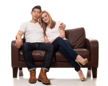 sofa: Young Couple on Sofa Stock Photo