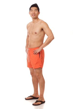 board shorts: Young man in swimwear. Studio shot over white.