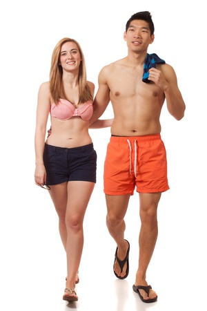 boardshorts: Young couple in swimwear. Studio shot over white. Stock Photo