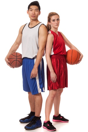 Male and female basketball players. Studio shot over white. photo