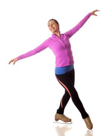 Young adult figure skater. Studio shot over white. Banco de Imagens