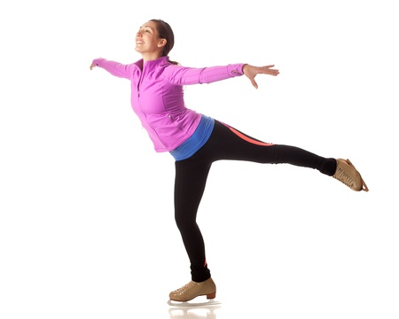 patinaje sobre hielo: Adulto joven patinadora art�stica. Estudio de disparo sobre el blanco.