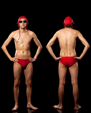 Male water polo player. Studio shot over black. photo