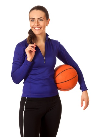 Adult woman with basketball. Studio shot over white. photo