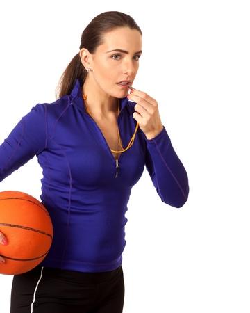 Womens basketball coach. Studio shot over white.