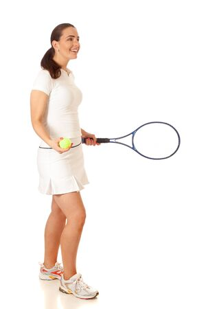 Adult woman playing tennis. Studio shot over white. photo