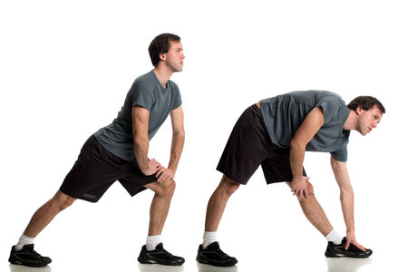 young adult man: Young adult man, stretching. Studio shot over white.