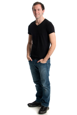 Young man in jeans and a black tee shirt. Studio shot over white. photo
