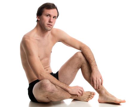 Man in underwear. Studio shot over white. photo