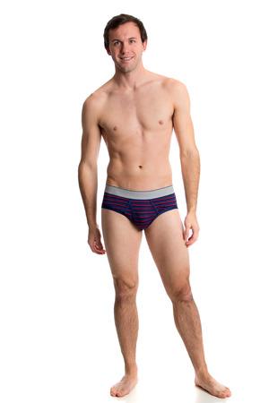 Man in underwear. Studio shot over white.