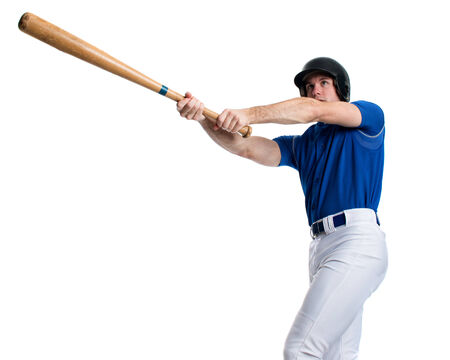 swinging: Young adult baseball player. Studio shot over white.