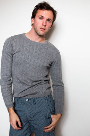 young adult man: Young adult man in a grey sweater
