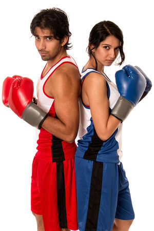 battle of the sexes: Male and female boxers Battle of the sexes. Studio shot over white.
