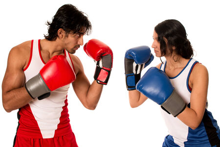 female boxing: Male and female boxers Battle of the sexes. Studio shot over white.