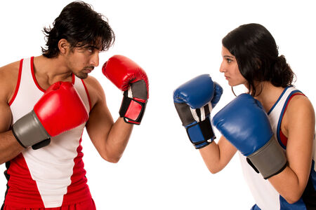 Male and female boxers Battle of the sexes. Studio shot over white.