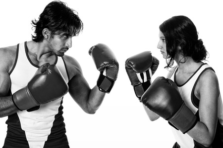 battle of the sexes: Male and female boxers  Battle of the sexes   Studio shot over white