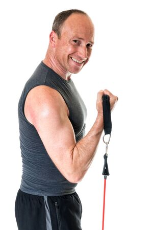 bicep: Bicep curl exercise with resistance band. Studio shot over white. Stock Photo