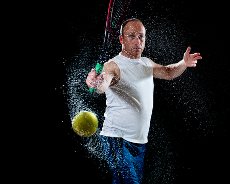 backhand: Tennis action shot. Backhand. Studio shot over black.