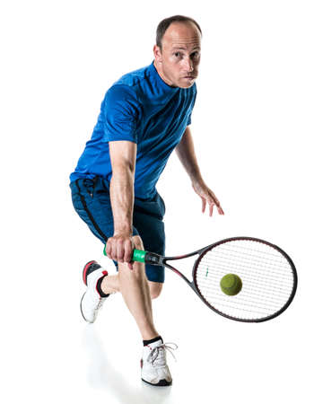 action shot: Tennis action shot. Backhand. Studio shot over white.
