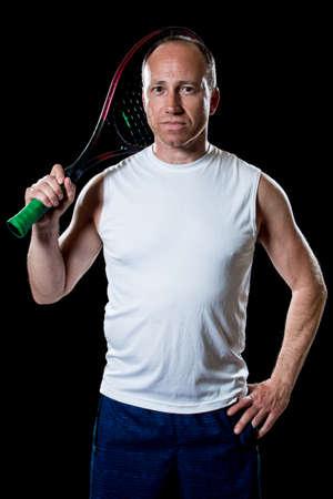 adult male: Adult giocatore di tennis maschile. Studio girato su nero.