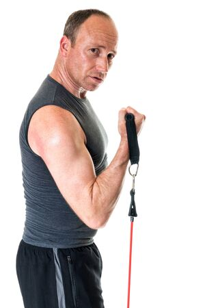 tricep: Bicep curl exercise with resistance band. Studio shot over white. Stock Photo