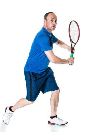 backhand: Tennis action shot. Backhand. Studio shot over white.