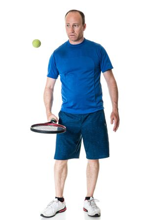 fourties: Adult male tennis player. Studio shot over white. Stock Photo