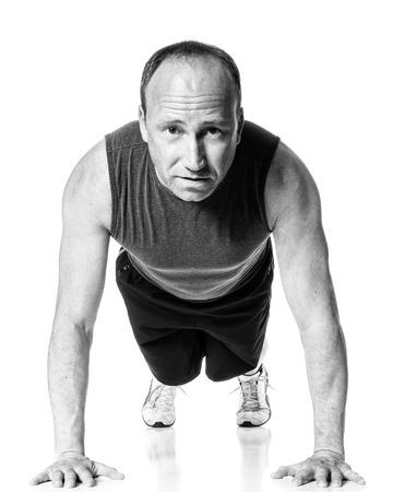 pushup: Push up exercise. Studio shot over white. Stock Photo