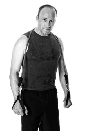 resistance: Adult man with a resistance band. Studio shot over white.