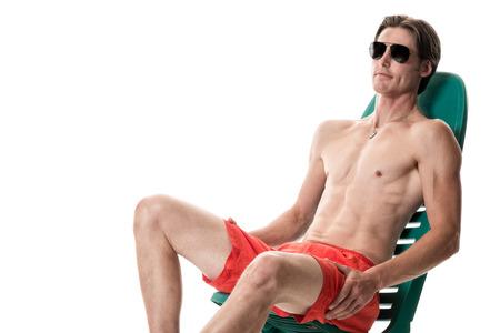 boardshorts: Man in swimwear. Studio shot over white. Stock Photo