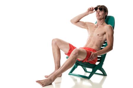 beach wear: Man in swimwear. Studio shot over white. Stock Photo