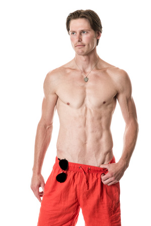board shorts: Man in swimwear. Studio shot over white. Stock Photo