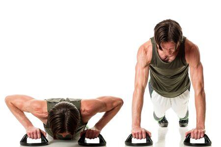 Push up exercise. Studio shot over white. Stock Photo