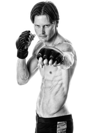 martial artist: Young adult martial artist. Studio shot over white. Black and white. Stock Photo