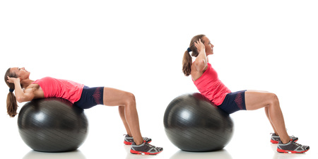 sit: Stability ball exercise. Studio shot over white. Stock Photo