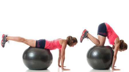 Stability ball exercise. Studio shot over white. Stock Photo