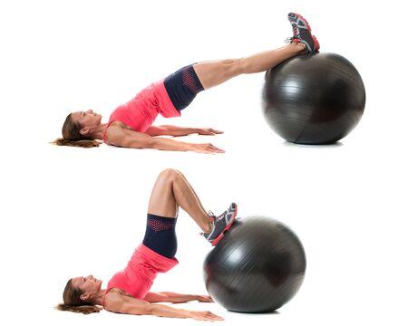 back exercise: Stability ball exercise. Studio shot over white. Stock Photo