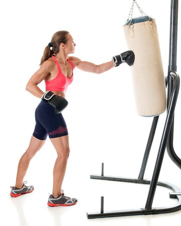 punched out: Heavy bag exercise. Studio shot over white.