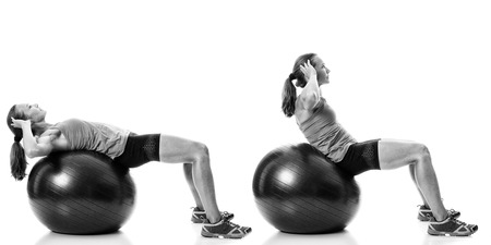 Stability ball exercise. Studio shot over white. Stock Photo