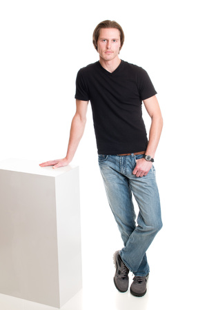 tee shirt: Man in jeans and black tee shirt. Studio shot over white.