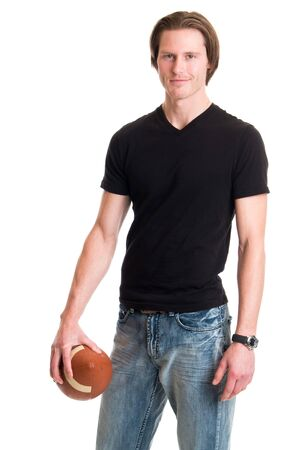 young men: Man in jeans and black tee shirt with football. Studio shot over white.