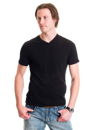 over white: Man in jeans and black tee shirt. Studio shot over white.