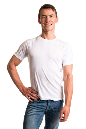 Young man in jeans and tee shirt. Studio shot over white. Stock Photo