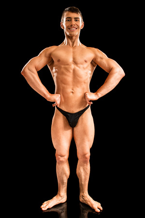 compulsory: Bodybuilder posing. Studio shot on black. Stock Photo
