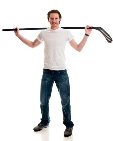 man shirt: Man in jeans and white tee shirt with ice hockey equipment. Studio shot over white. Stock Photo